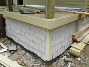 Shingle-style skirt being installed on porch of 1017A Waverly